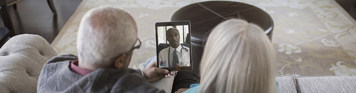 Older couple using Video Visit to speak to their Beaumont doctor