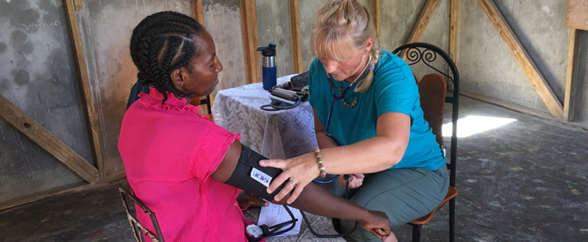 Checking a patient's blood pressure in in Haiti