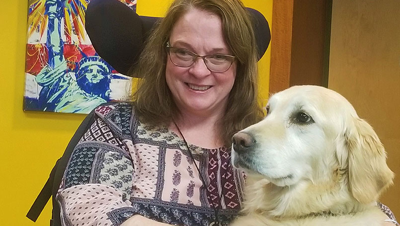 Sheryl with her service dog